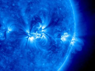 An image of the sun in ultraviolet light showing a string of active regions near the Sun's equator over about 36 hours.