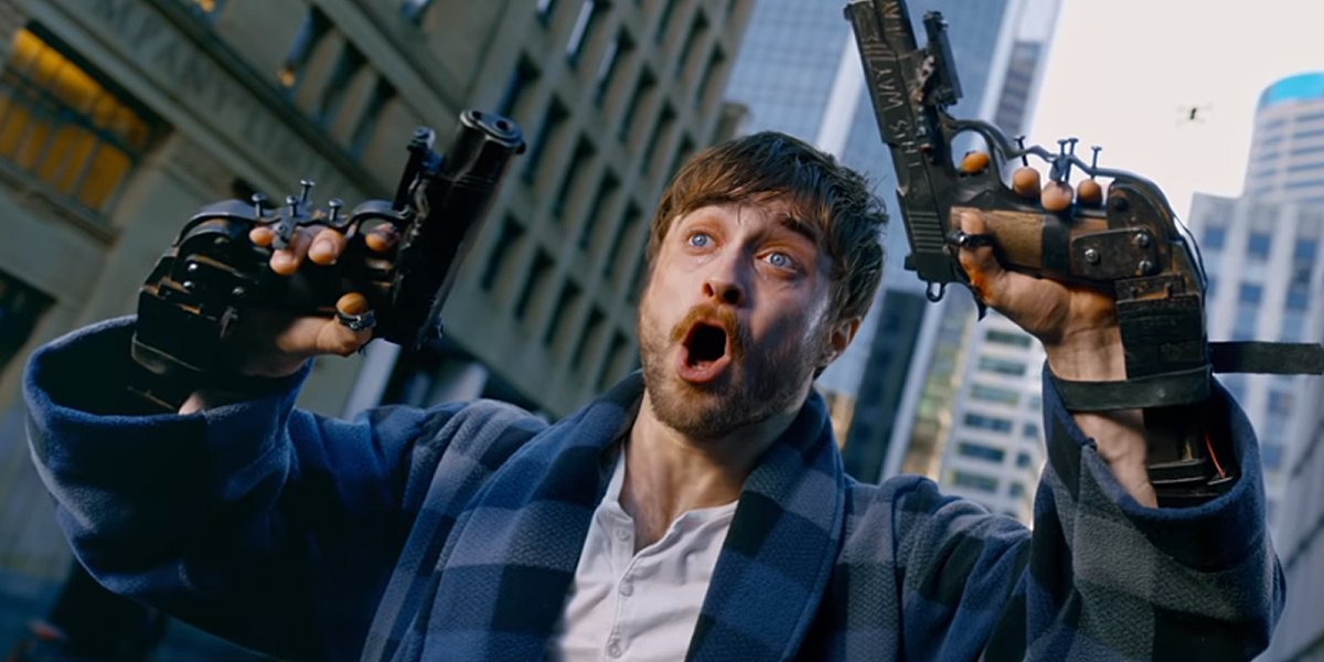 Daniel Radcliffe holding two guns in Guns Akimbo trailer shot