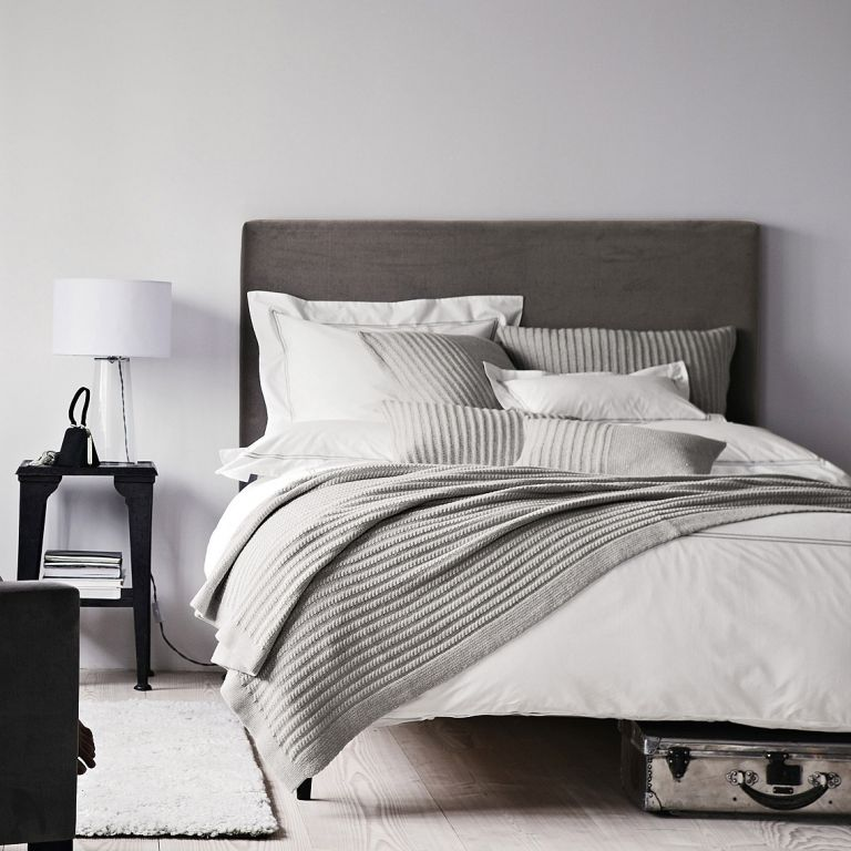 Bed deals: White bedroom with grey upholstered bed