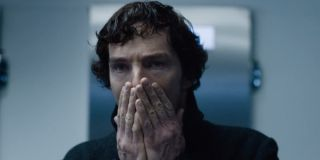 Sherlock covering his mouth with his hands