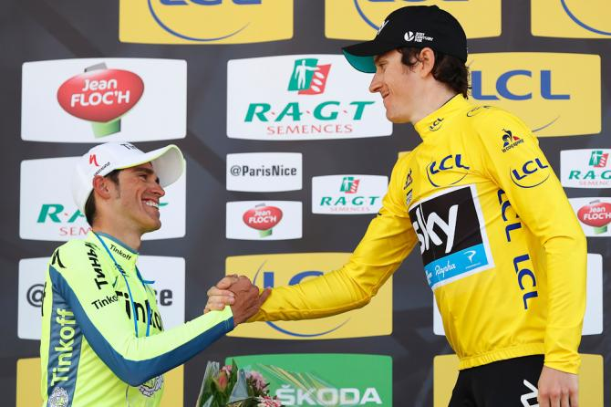 Geraint Thomas (R) shakes hands with Spain's Alberto Contador on the podium