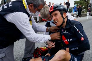 Geraint Thomas receives medical treatment after crashing during the 3rd stage of the 2021 Tour de France