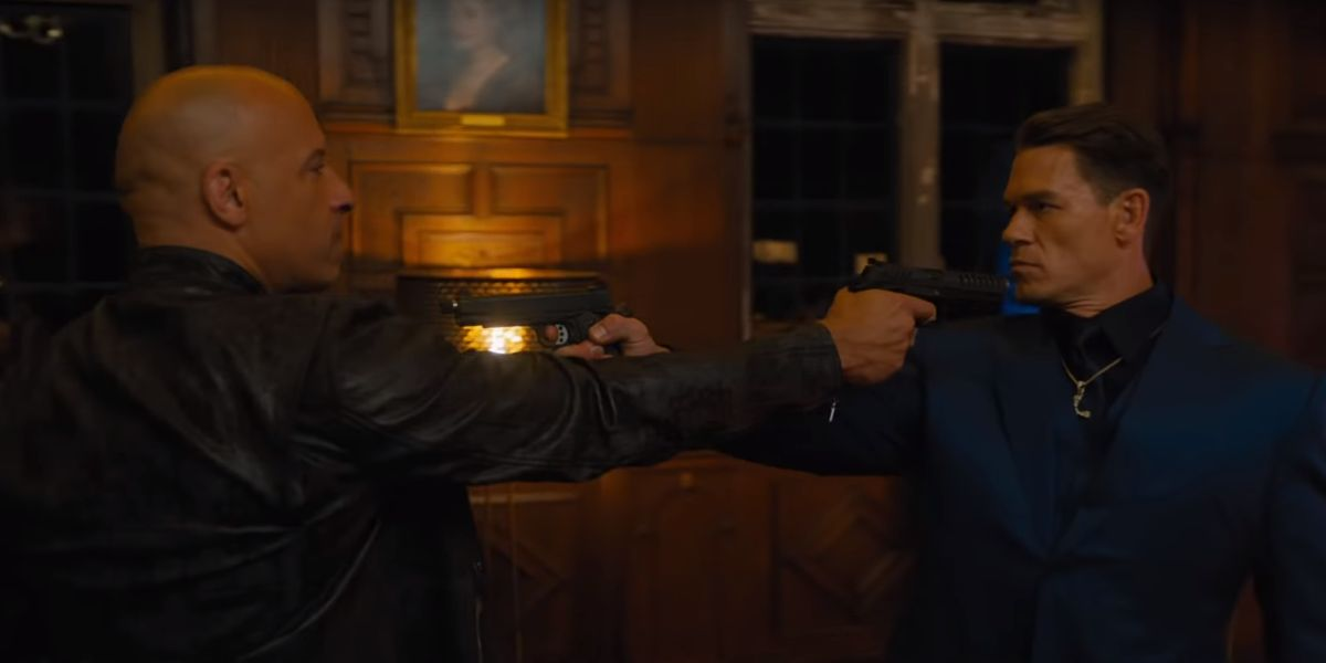 Vin Diesel and John Cena pointing guns at each other in F9
