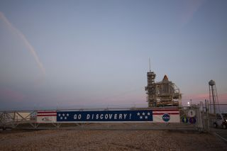 Photo of space shuttle Discovery at launch pad for final launch on the STS-133 mission
