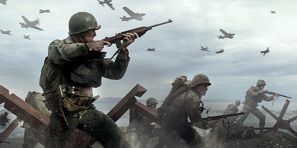 Soldiers storm the beach in Call of Duty: WWII.