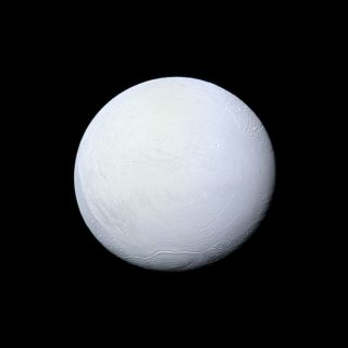 Saturn's moon Enceladus, covered in snow and ice, resembles a perfectly packed snowball in this image from NASA's Cassini mission released on Dec. 23, 2013.