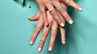 Woman's hands wearing stacked rings