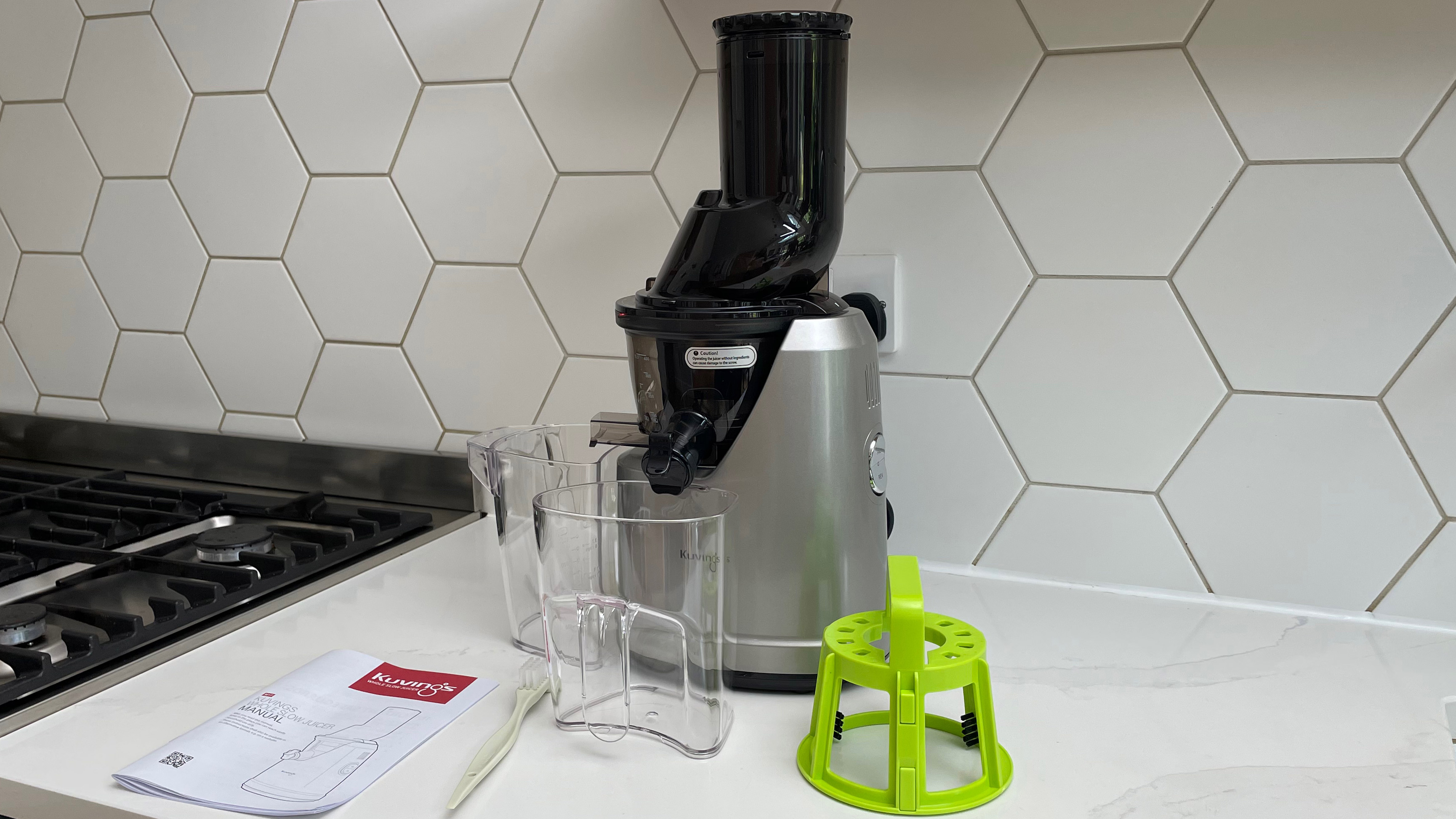 Kuvings B1700 and its accessories on a kitchen countertop