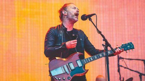 Thom Yorke from Radiohead singing on stage
