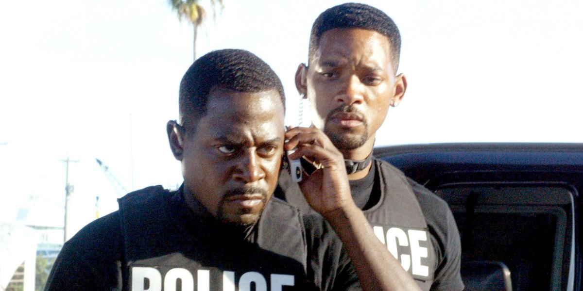 Bad Boys II Martin Lawrence takes an phone call angrily, with Will Smith looking on worried