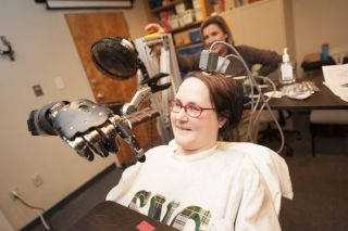 quadriplegic uses mind-controlled prosthetic