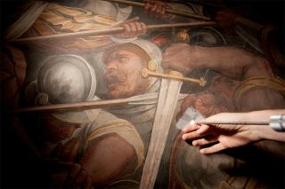 """Researchers threaded the endoscope into the wall covered by the Vasari mural to find signs of the lost Leonardo painting """"The Battle of Anghiari"""" in Florence's Palazzo Vecchio."""