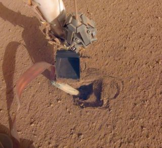 "NASA's Mars InSight lander recently moved its robotic arm closer to its digging device, called the ""mole,"" in preparation to push on its top, or back cap. Photo released on Feb. 21, 2020."