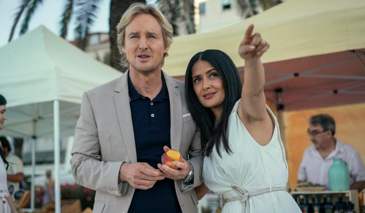 Bliss Owen Wilson and Salma Hayek walking in Isabel's reality