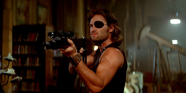 Kurt Russell Snake Plissken Escape From New York holding gun
