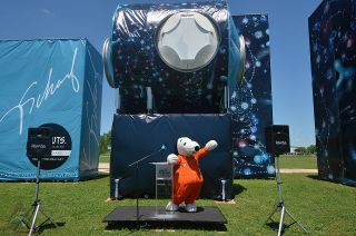 Snoopy, wearing a custom NASA spacesuit, poses before Kenny Scharf's art installation outside Space Center Houston in Texas on Thursday, April 25, 2019. The installation features Scharf's space-themed Peanuts mural wrapped around a retired training mockup of an International Space Station module