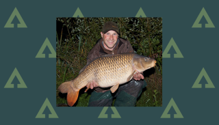How to catch carp on bread - Colin Davidson holding a carp caught using bread