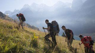 best hiking backpacks: backpackers ascending