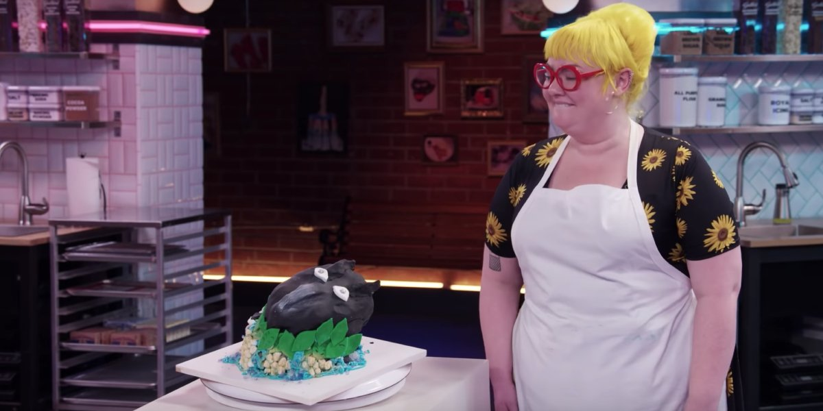 A contestant shows off her baking masterpiece on Netflix's Nailed It!