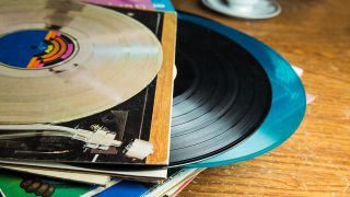 A photograph of records and their sleeves