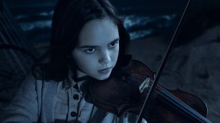 ryan kiera armstrong's alma playing violin in american horror story double feature