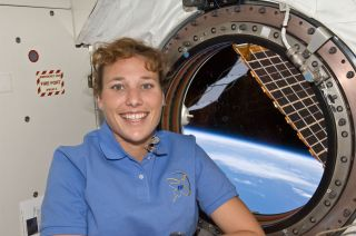 NASA astronaut Dorothy Metcalf-Lindenburger, STS-131 mission specialist, poses for a photo near a window in the Kibo laboratory of the International Space Station, on April 14, 2020.
