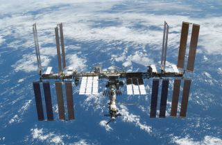 """Two Russian cosmonauts will take a spacewalk outside the International Space Station on Monday, Aug. 10. Expedition 44 commander Gennady Padalka and flight engineer Mikhail Kornienko will retrieve an experiment and install so-called """"gap spanners"""" that wi"""