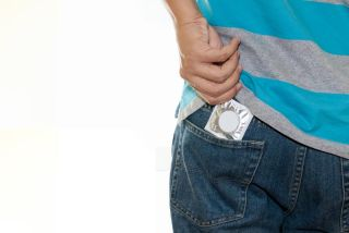 condom in the back pocket of a guy's jeans