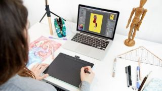 best Wacom tablet - Woman using Wacom tablet to draw on her laptop