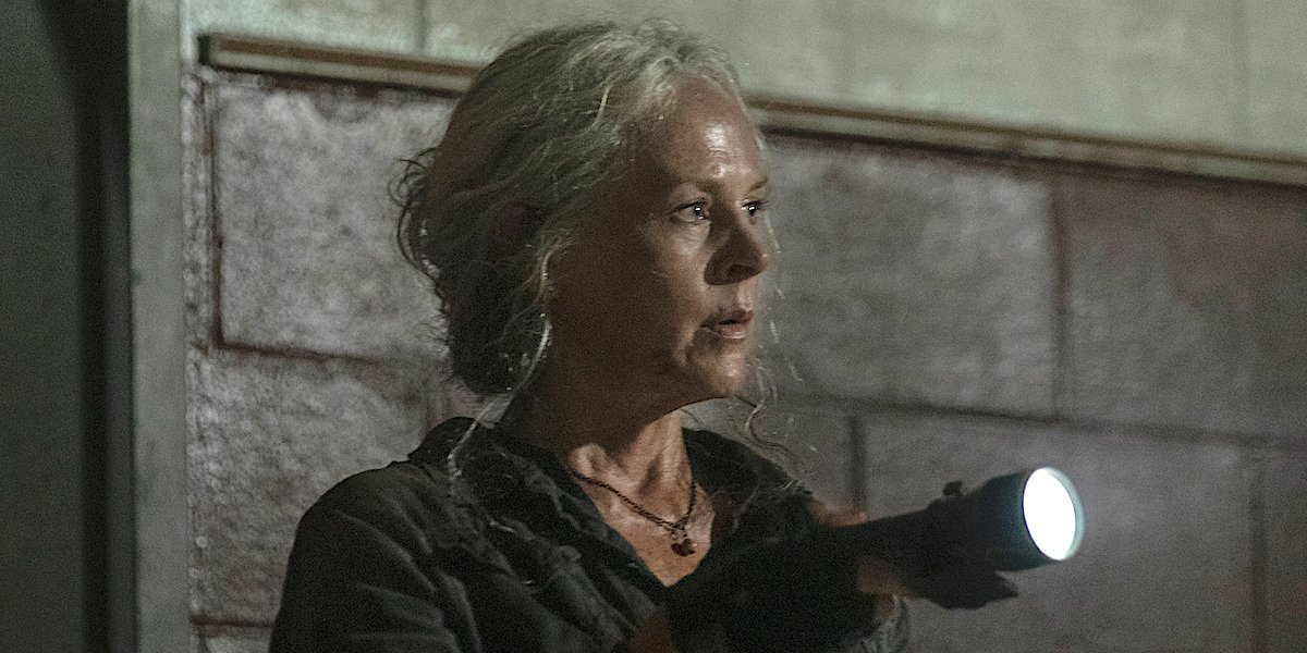 carol with a flashlight the walking dead