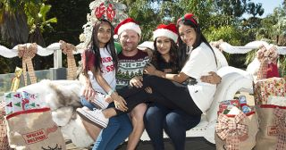 The Sharma-Rebecchi's 'Christmas in July' photoshoot for their Face of Lassiters poster in Neighbours.