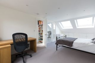 Loft conversion featuring bed, bathroom and office space