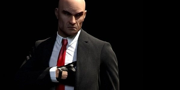 Agent 47 reaches for his gun in Hitman