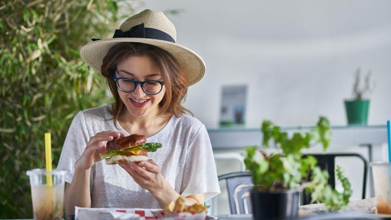 Woman eating a meat-free vegan burger