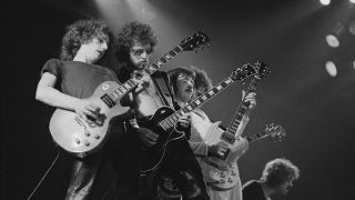 Blue Oyster Cult onstage, July 30, 1976. (from left) Allen Lanier, Eric Bloom, Buck Dharma, and Joe and Albert Bouchard