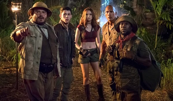 Jumanji: Welcome To The Jungle Dwayne Johnson and cast look into the distance