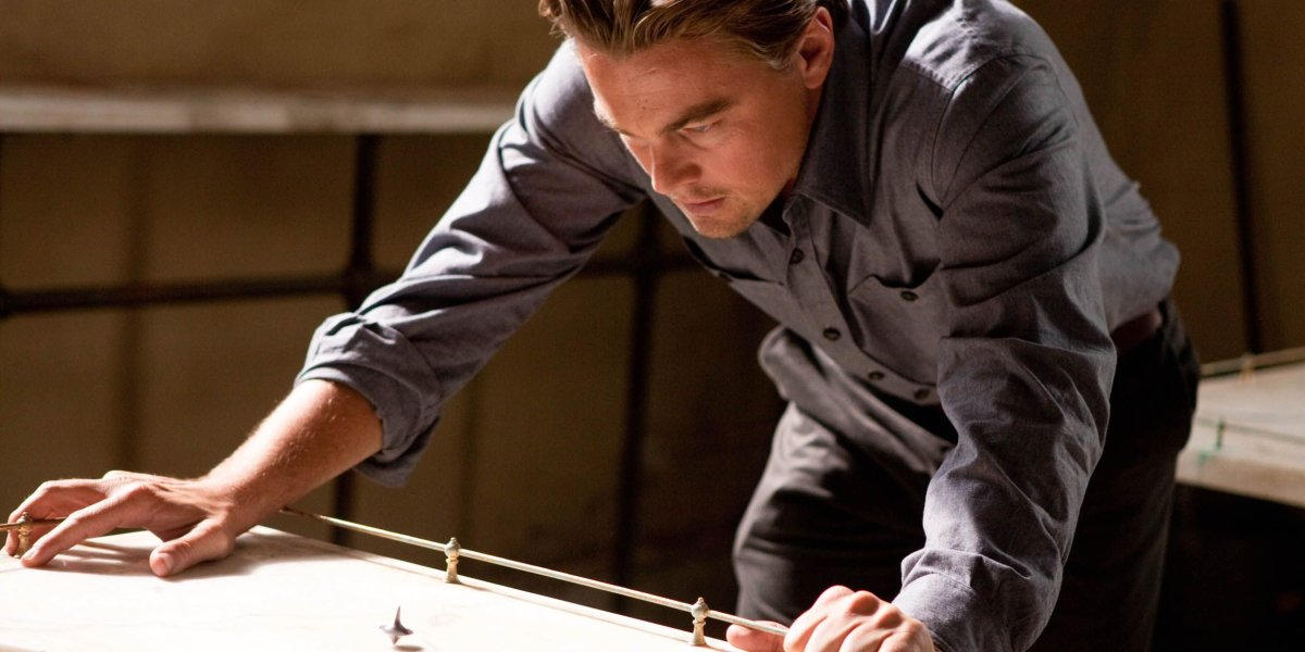 Leonardo DiCaprio stares at his spinning top in Inception.