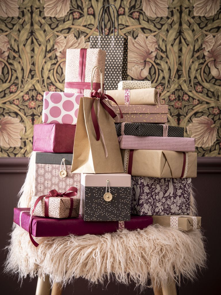 Christmas gifts in a pile by Maisons du Monde