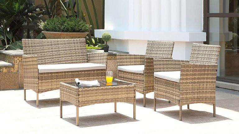 Garden furniture sales: Salbay Rattan Garden Furniture Set in white back garden with orange juice on table