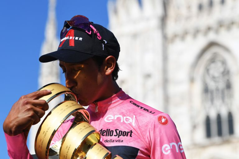 Egan Bernal kisses the Giro d'Italia trophy in the pink jersey after winning the 2021 edition of the race