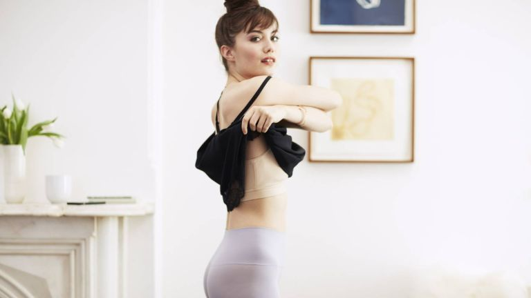 How to wear shapewear: Woman taking off dress and revealing her shapewear