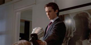 American Psycho Christian Bale holding a nail gun
