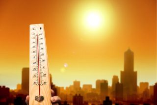 The mercury rises within a thermometer on a hot day.