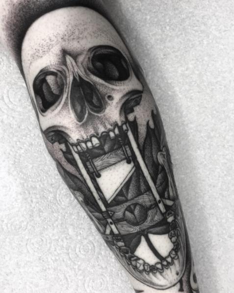 Gruesome skull tattoo