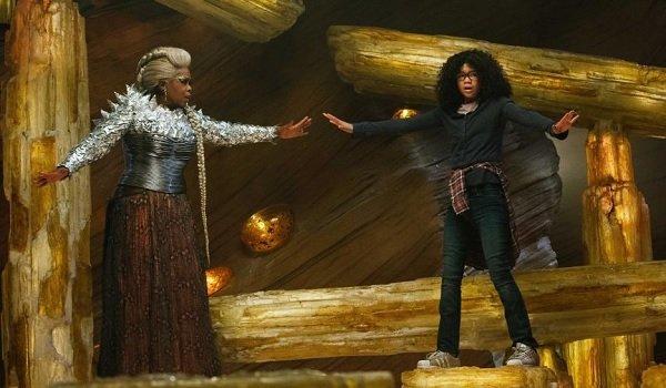 A Wrinkle In Time Oprah Winfrey Storm Reid making their way through a cavern