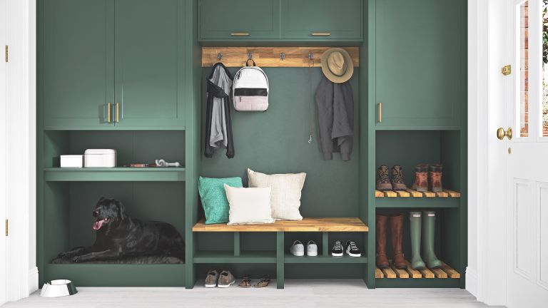 small boot room with green cabinets and bench
