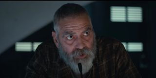 The Midnight Sky George Clooney sitting in front of a microphone, beard and all