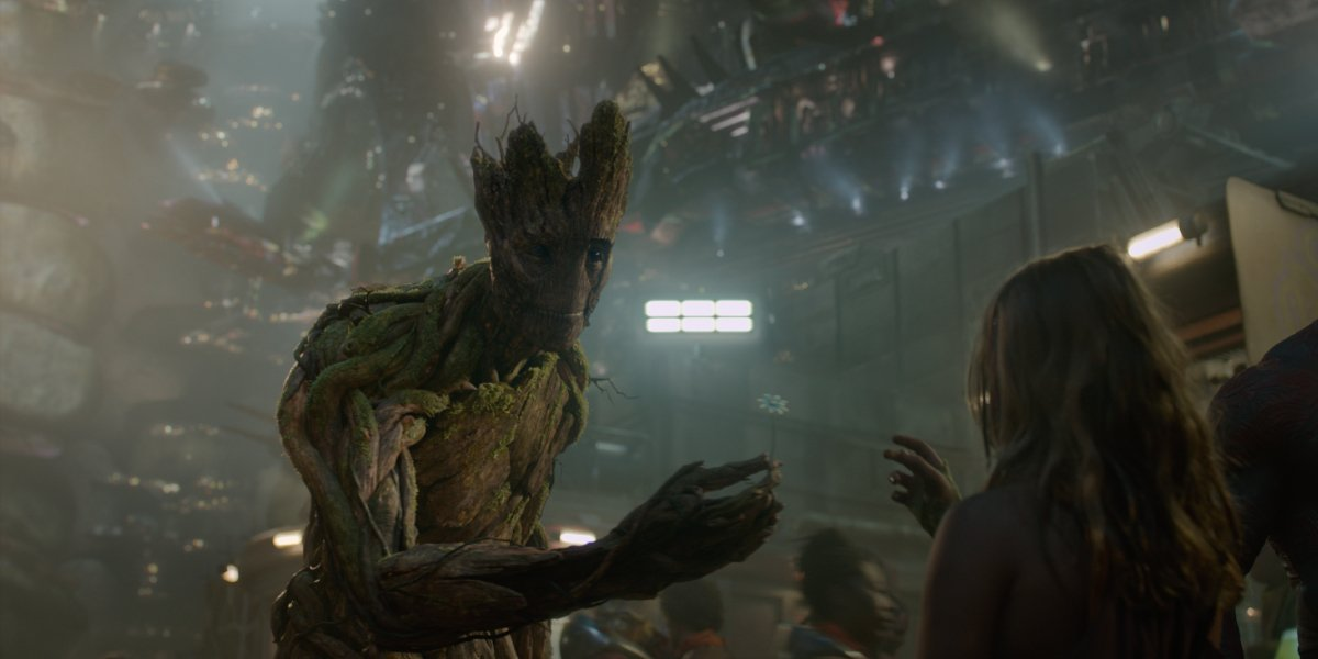 Groot (Vin Diesel) giving a flower to a young girl in Guardians of the Galaxy