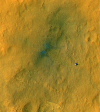 Mars rover Curiosity's tracks on Mars seen from space in this image released Sept. 6, 2012.