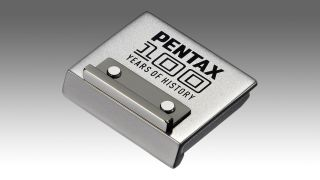 Pentax celebrates 100th anniversary with… limited edition $50 hot shoe cover?